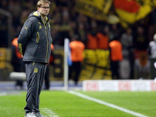 Dortmund's head coach Juergen Klopp attends the German Bundesliga soccer match between Hertha BSC Berlin and Borussia Dortmund at the Olympia stadium in Berlin, Germany, Saturday, Dec. 13, 2014. (AP Photo/Michael Sohn)