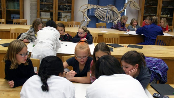 A group of third and fourth grade girls attend a STEM camp at Simpson College on Nov. 4. The event was hosted by Simpson and AAUW and was designed to help get girls interested in Science, Technology, Engineering and Math related career fields.