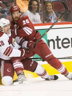 Coyotes defenseman Chris Summers (20) checks Coyotes forward Jordan Martinook (48) during an intrasquad scrimmage at Gila River Arena in Glendale on Saturday, September 27, 2014.