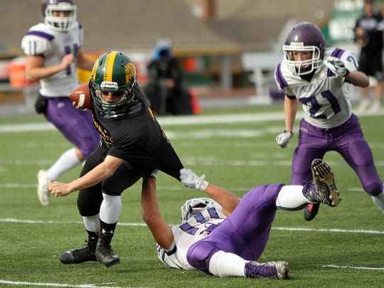 Burr and Burton's Ray Gormley is tackled by Bellows Falls' Jahyde Bullard in the second half of the Bulldogs' 28-7 win over Bellows Falls in the Division II state high school football championship game on Saturday, Nov. 7, 2015.
