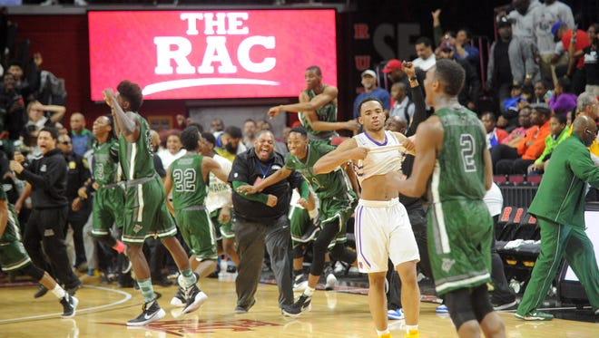 Camden's Corey Greer walks off the court as West Side celebrates its Group 2 boys basketball championship win at Rutgers University. 3.13.15