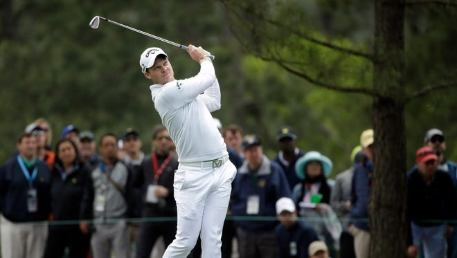 Danny Willett hits his second shot on the 1st hole during the final round of the Masters on April 10, 2016.