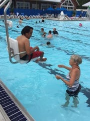 Thanks to an ADA lift chair, Marky Beatty was able to enjoy Lakeside's new pool with his mother, Becky Donithan, on Thursday.