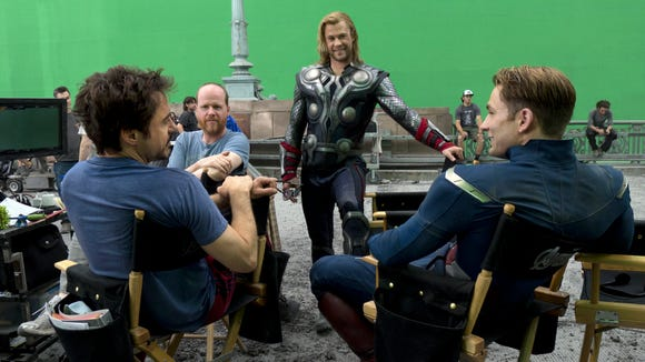 Joss Whedon hanging with some heroes on the set of