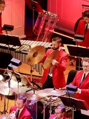 Michael Culligan, percussionist with the Cincinnati Symphony Orchestra, plays the cymbols at a recent Cincinnati Pops concert.
