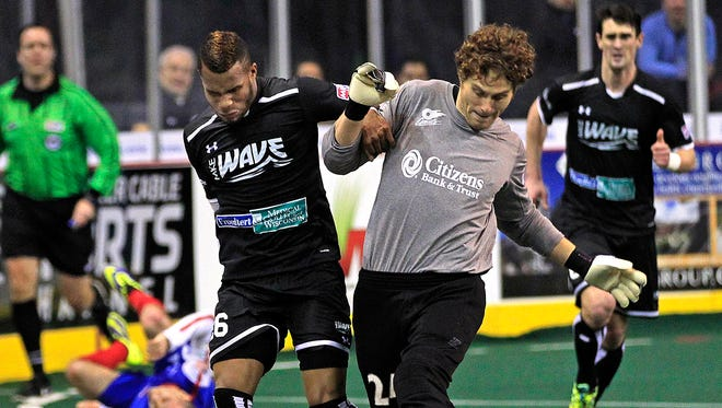 Milwaukee Wave forward Ian Bennett tries to wrestle the ball away from way-out-of-position Missouri Comets goalie Danny Waltman.