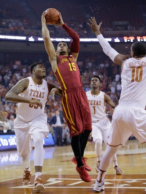 Iowa State's Naz Long (15) shoots between Texas' Cameron Ridley (55) and Jonathan Holmes (10) during the first half of an NCAA college basketball game, Saturday, Feb. 21, 2015, in Austin, Texas. Iowa State won 85-77.
