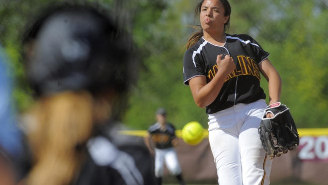 Farmington HIlls Mercy pitcher Andrea Elmore worked out of trouble in several innings after giving up a two-run single in the first inning to her counterpart for Allen Park Cabrini, Nadia Hazimeh.
