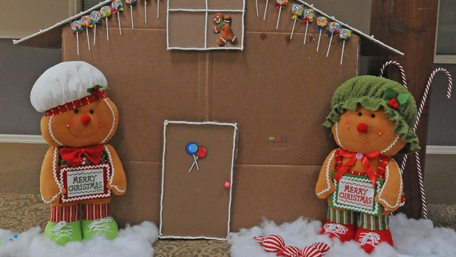A gingerbread house decoration is part of the Candyland display in the court of Arbor Court Retirement Community, 1000 Schippel Drive in Salina, that was finished on Friday. The display was made by executive director Kristi Bruner and activities director Kim Sullivan in hopes of increasing the Christmas spirit and joy to the residents this holiday season.