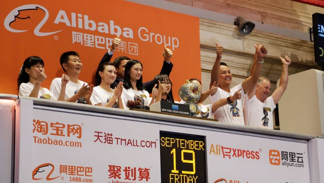 Alibaba employees attend the opening bell ceremony during the company's IPO at the New York Stock Exchange, Friday, Sept. 19, 2014 in New York.