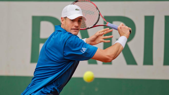 John Isner (USA) in action  against Andreas Seppi (ITA) on day three of the French Open at Roland Garros on May 26, 2015.