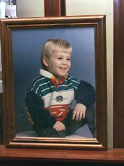A portrait of Derrick Robie, taken when he was four, is displayed on an easel in the Robie's home in 2004.