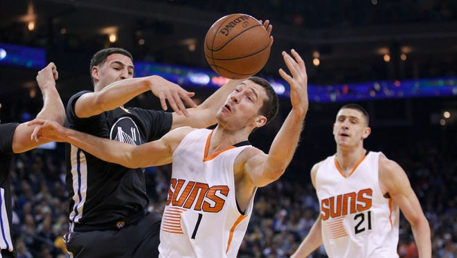 Jan. 31, 2015: Phoenix Suns guard Goran Dragic (1) has his shot blocked by Golden State Warriors guard Klay Thompson (11) in the first quarter at Oracle Arena.