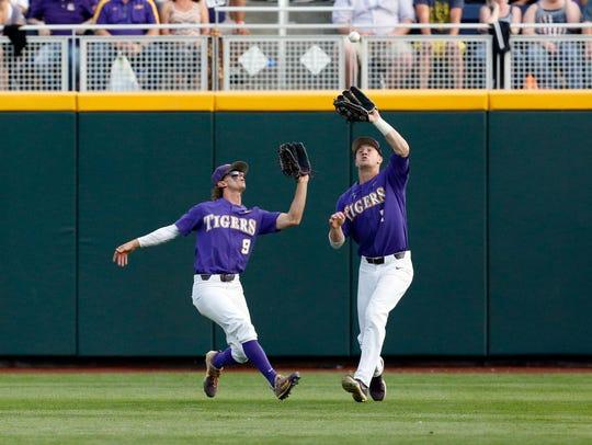 LSU center fielder Zach Watson (9) and right fielder