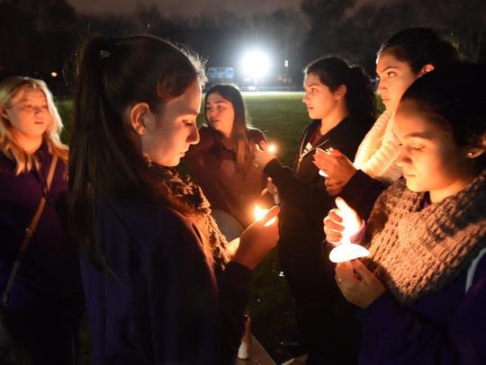 Hundreds attended a candlelight vigil Tuesday for Saddle