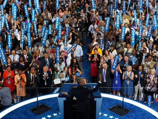 President Barack Obama waves to the delegates before