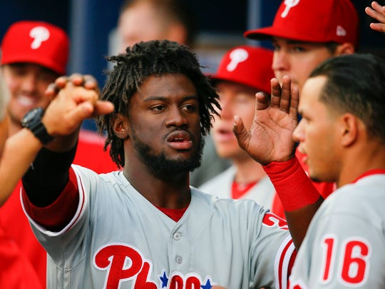 Philadelphia's Odubel Herrera reacts with teammates