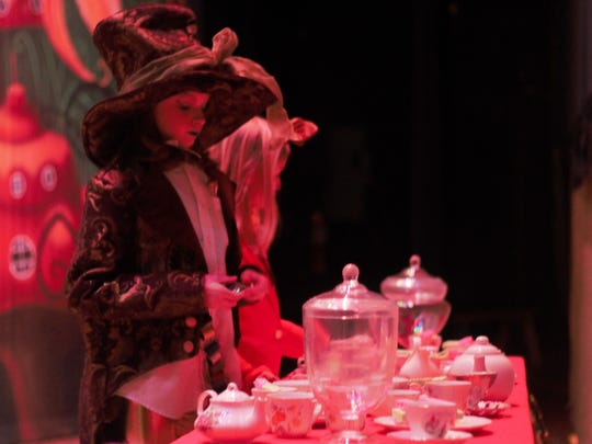 Macie Snyder who plays the Mad Hatter waits for the curtain to go up during a dress rehearsal on Tuesday.