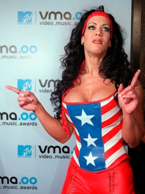 In this file photo, WWF wrestler Chyna arrives for the 2000 MTV Video Music Awards at New York's Radio City Music Hall. Chyna, the WWE star who became one of the best known and most popular female professional wrestlers in history in the late 1990s, has died at age 45.