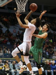 Northstar's Miles Brown, left, drives in and is fouled