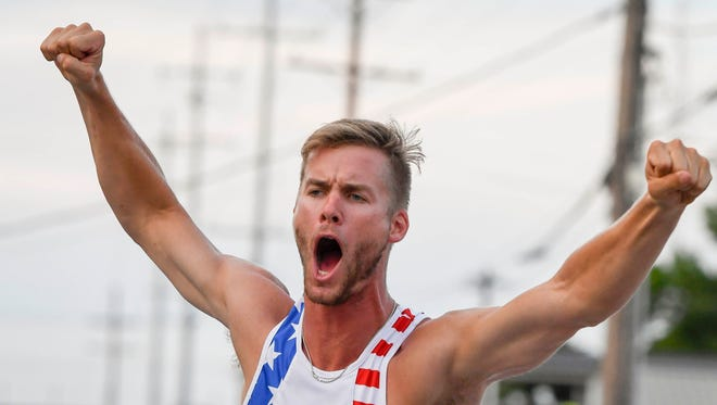 """Scott Houston reacts to clearing 18'-2""""1/2 at the Jammin' & Jumpin' Street Vault event at the Henderson riverfront Tuesday. The former Indiana University and University of North Carolina pole vaulter won the event in it's eleventh year, July 4, 2017."""