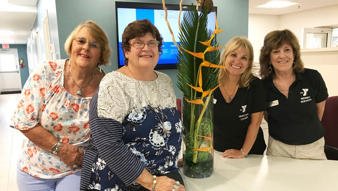 Sue Oldershaw and Lindy Kowalczyk, from left, with their design at Marco YMCA, with Deborah Passero and Lily Bardon.