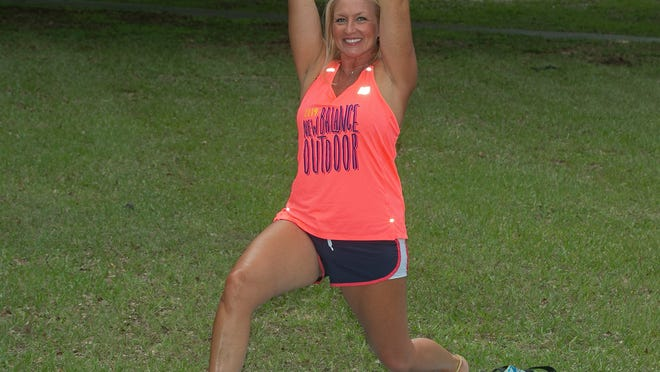 Marlo Alleva shows a deep lunge with overhead tricep extension.