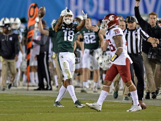 Michigan State Spartans wide receiver Felton Davis III (18) gestures at Washington State Cougars safety Hunter Dale (26) after a second quarter catch in the 2017 Holiday Bowl at SDCCU Stadium.