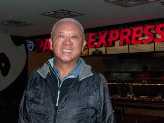 Panda Express co-founder and co-CEO Andrew Cherng stands