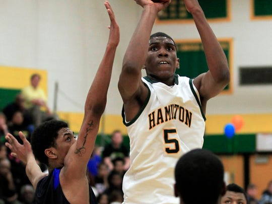 Milwaukee King Diamante Freeman (32)  can't stop  Milwaukee Hamilton Kevon Looney (5) from hitting a shot at the top of the key during the prep boys basketball game at Milwaukee Hamilton on Feb. 12, 2013.