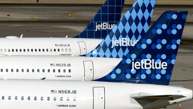 JetBlue airplanes at the New York JFK Airport on Feb. 23, 2004.