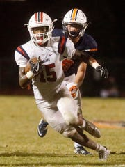 Oakland's Jeron Rooks (15) runs the ball as Blackman's Conner Murphy (9) moves in from behind during the game, on Friday, Sept. 22, 2017, at Blackman.