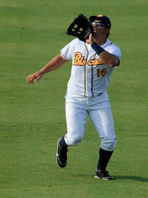 Montgomery Biscuits outfielder Alejandro Segovia (16) makes a catch against the Jacksonville Suns at Riverwalk Stadium in Montgomery, Ala. on Sunday July 27, 2014.