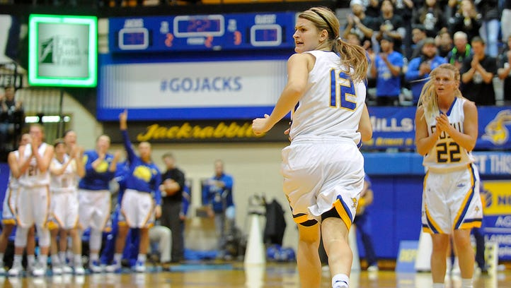 The crowd cheers for SDSU's #12 Macy Miller after shoot a three-pointer against NDSU during basketball action at Frost Arena in Brookings, S.D., Saturday, Feb. 6, 2016.