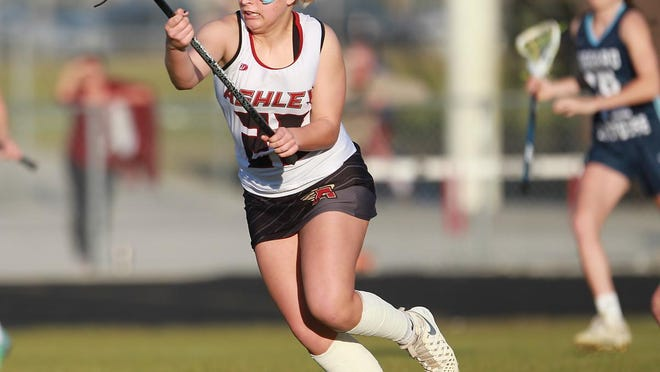 Ashley graduate Averee Gerold carries the ball upfield in a match against Hoggard in 2017. Gerold is set to continue her lacrosse career at Bournemouth University in Englad this coming school year.