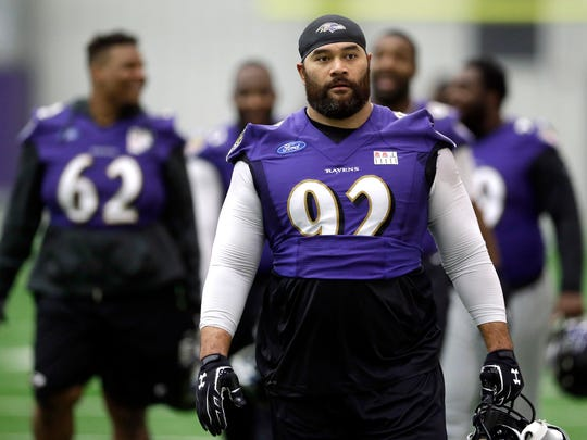 Baltimore Ravens defensive end Haloti Ngata walks off the field after practice Tuesday, in Owings Mills, Md. Ngata is returning from a four-game suspension for using the amphetamine Adderall.