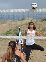 Cousins Janessa Simental of Ventura College and Cassidy Simental of Moorpark College (foreground) faced off against each other at No. 1 doubles during the historic first women's beach volleyball match between VC and MC on Friday morning at Ventura Harbor.