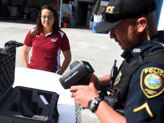 Stephanie Stuart looks on as Fellsmere Police Officer