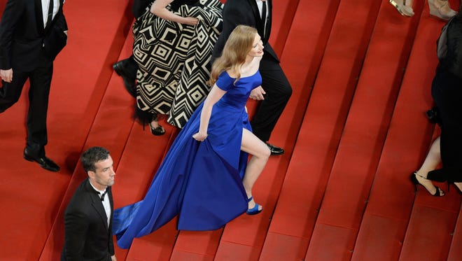 Jessica Chastain walks the Cannes red carpet in a flowing Versace gown on Saturday night.