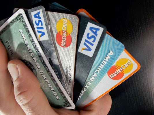 636645171399925114-AP-NerdWallet-Keys-Debt-Con.jpg