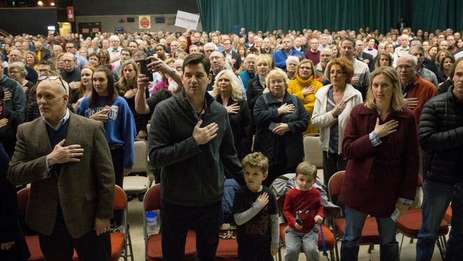 Caucusgoers take the Pledge of Allegiance at 7 Flags Event Center in Clive in 2016.