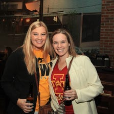 Hope Wilson, 22, and  Melanie See, 22, watch the Iowa State vs. Iowa game at Wellman's Pub and Rooftop.