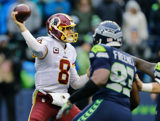Washington Redskins quarterback Kirk Cousins passes
