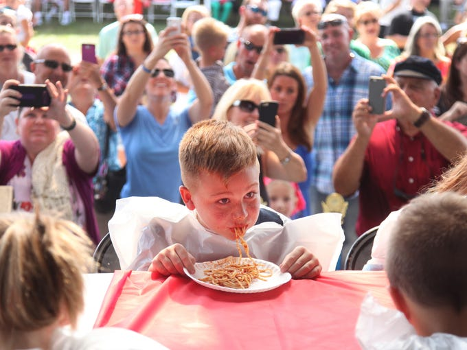 Julian Arbolaez, 9, looks up with a mouth full of spaghetti