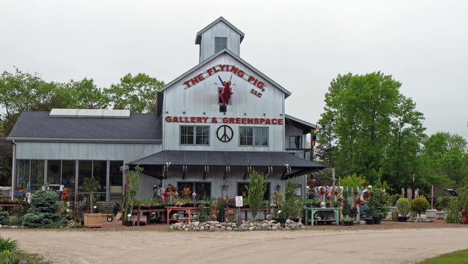 On the outskirts of Algoma is an art gallery on lush acreage that hosts a farmers market on summer Sundays.