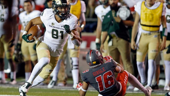 Bisi Johnson, shown running past New Mexico safety Jacob Girgle during a game last season, is one of only a handful of returning starters on the CSU football team's offense this season. There will be a lot of new faces and names on the field for the Rams this fall.