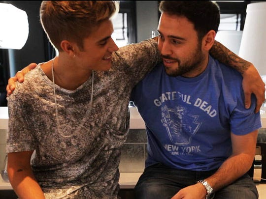 "Justin Bieber chats with his manager and close friend Scooter Braun in a scene from ""Justin Bieber's Believe."""