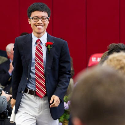 Yifan Zhong smiles as he returns to his seat after