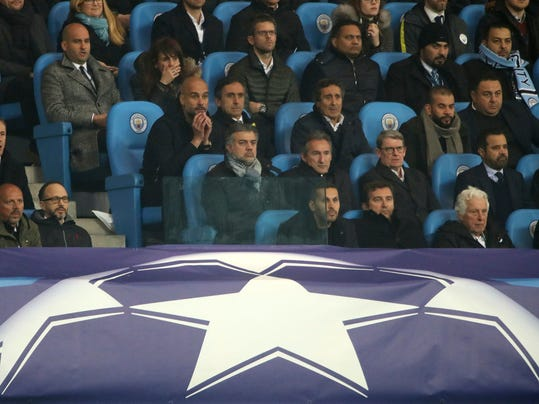 Manchester City manager Pep Guardiola, center, watches from the stands during the  Champions League, quarterfinal second leg soccer match against Liverpool at the Etihad Stadium, Manchester, England Tuesday April 10, 2018. (Nick Potts/PA via AP)