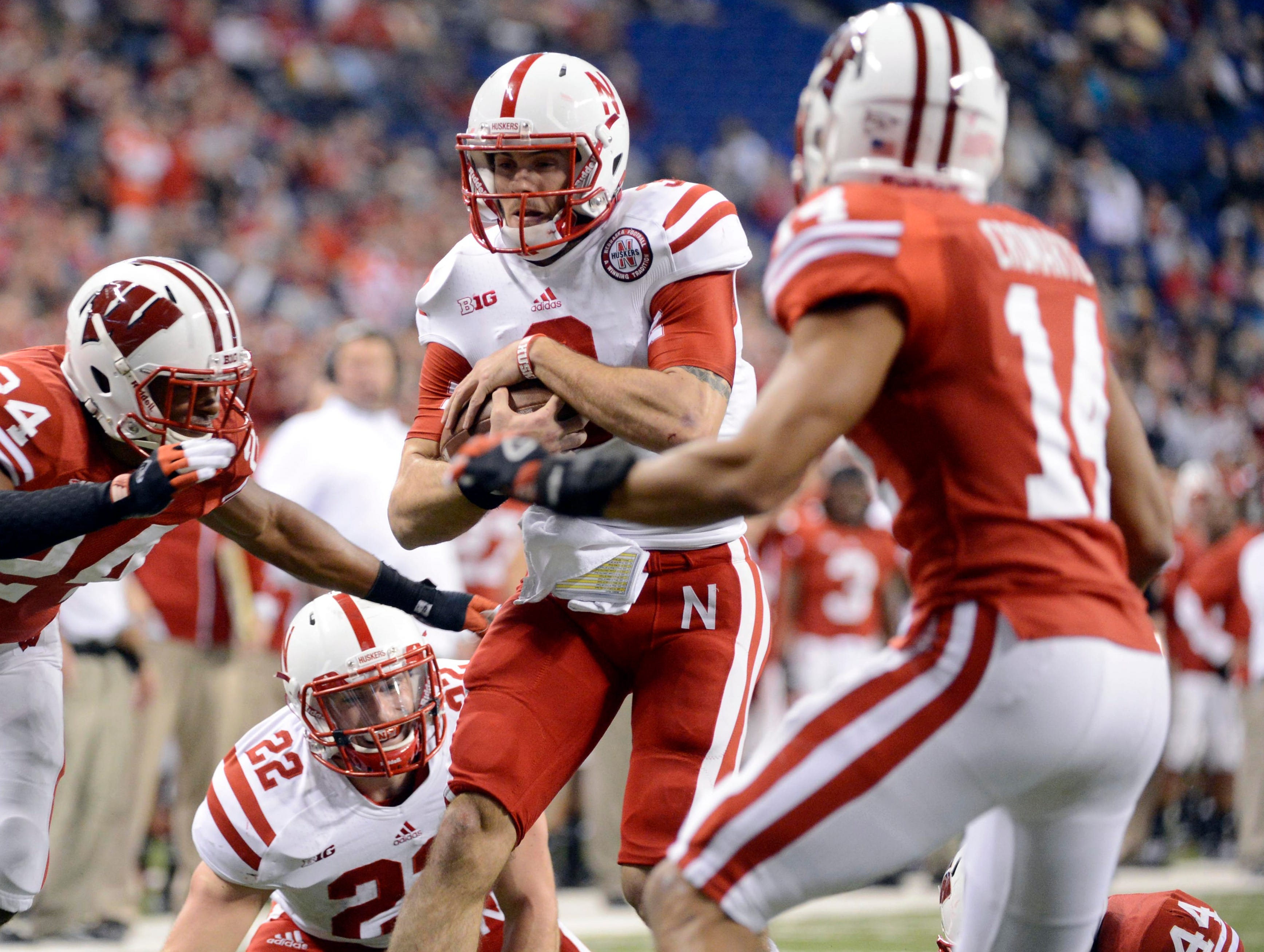 Nebraska quarterback Taylor Martinez runs in an 11-yard touchdown in the third quarter against Wisconsin in the Big Ten title game.